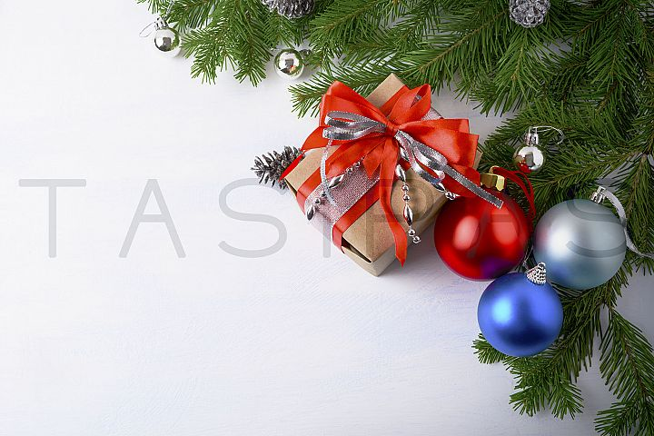 Christmas background with gift box and multicolored ornament