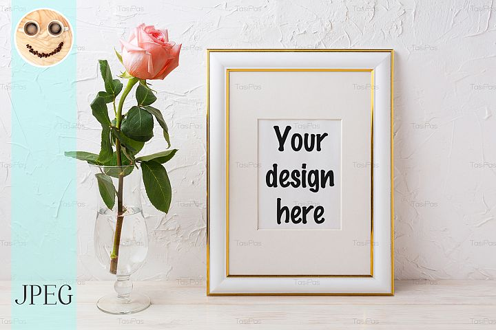 Gold decorated frame mockup with rose in glass vase
