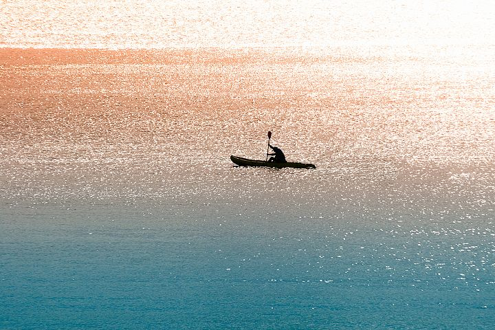 Sea canoeist at dawn