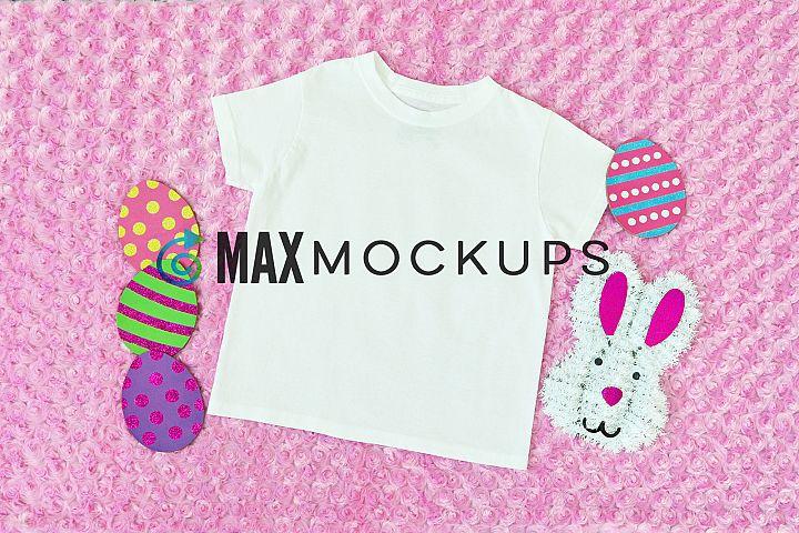 Kid shirt Easter mockup, eggs bunny girl, flatlay stock