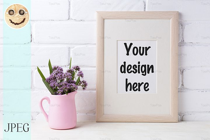 Wooden frame mockup with purple flowers in pink pitcher