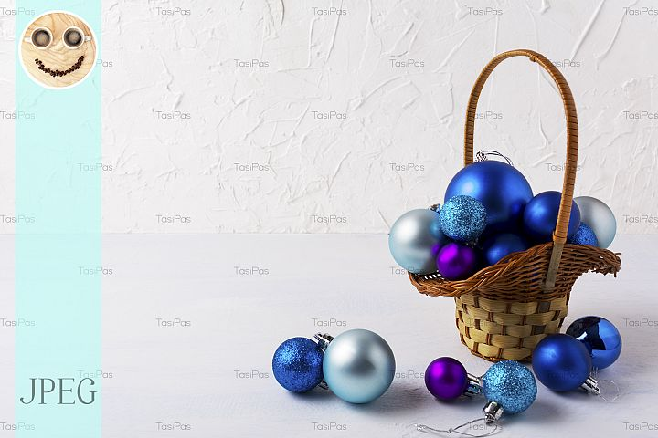 Christmas background with blue ornaments in wicker basket