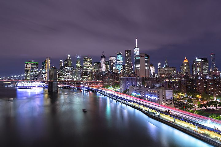 Aerial night view on East River with Dumbo Brooklyn bridge