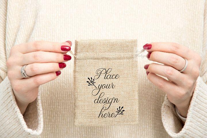 PSD burlap bag mockup girl holding jute drawstring gift sack