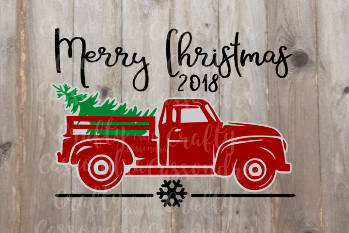 Vintage pickup truck hauling away a Christmas tree
