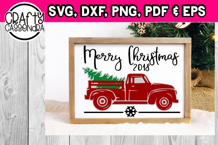 Vintage pickup truck hauling away a Christmas tree