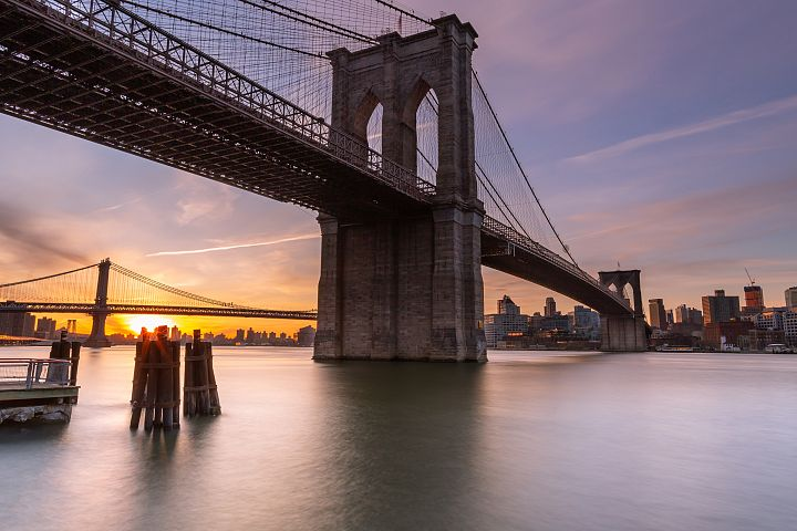 Brooklyn Bridge at sunrise from East River