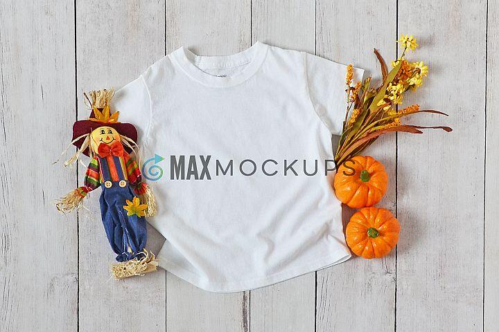 Kids t-shirt mockup, Halloween pumpkin scarecrow, styled