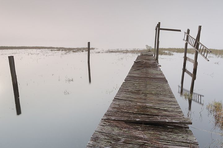 View on abandoned pier on a foggy morning