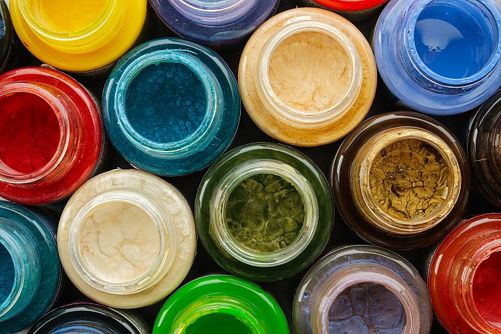Colorful paints, stained glass or oil, acrylic paints