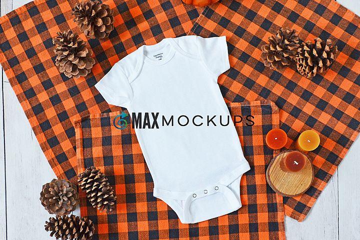 Baby bodysuit Mockup, orange plaid, flatlay stock photo