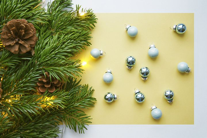 Christmas and New Year yellow background and blue balls