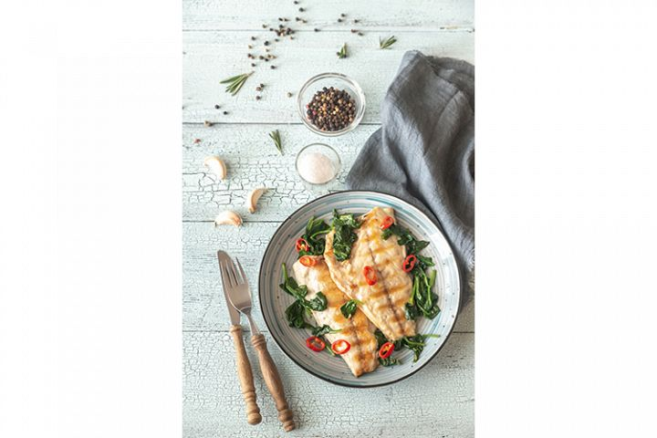 Grilled sea bream fish fillet with spinach