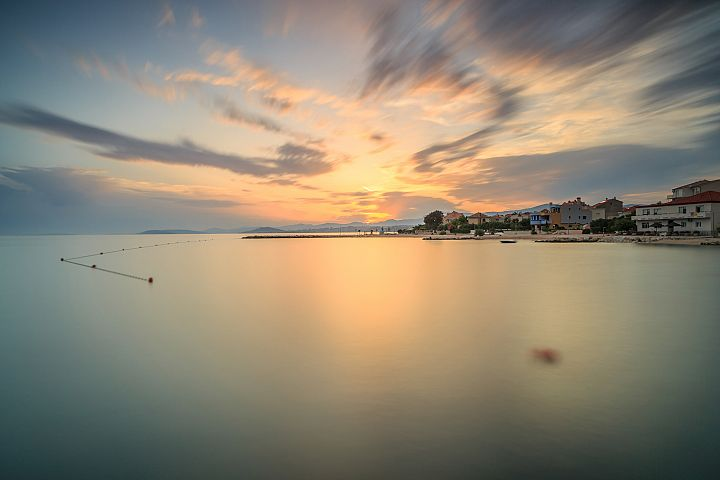 Sunset at adriatic sea in Croatia,with villas