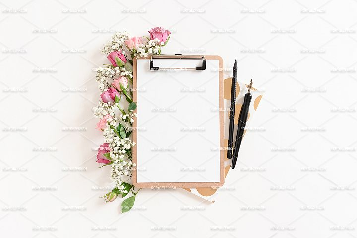 Flatlay of clipboard mockup with frame made of stationery