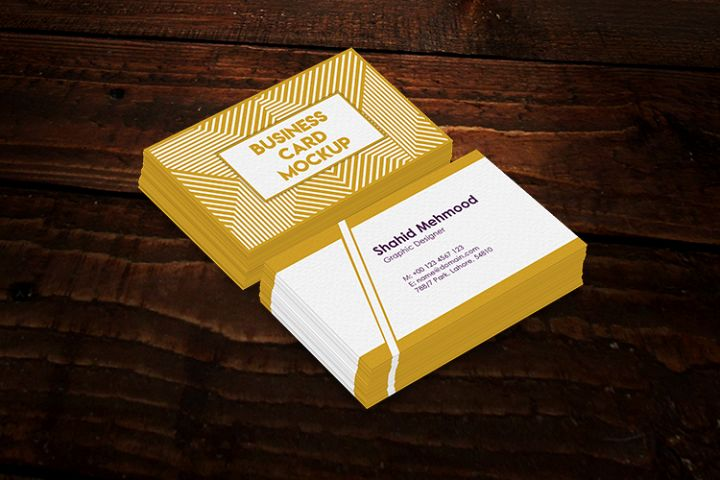 Realistic Business Card Mockups on a wooden background