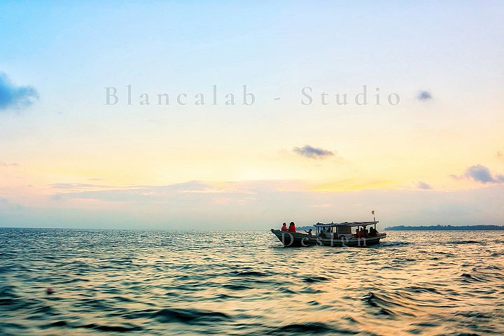 Traditional Fisherman in Sunset Sea