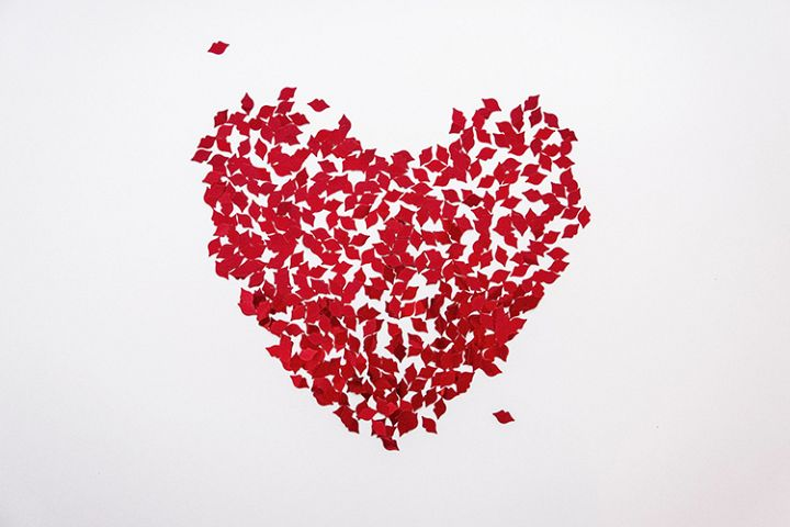White background with red heart of lips