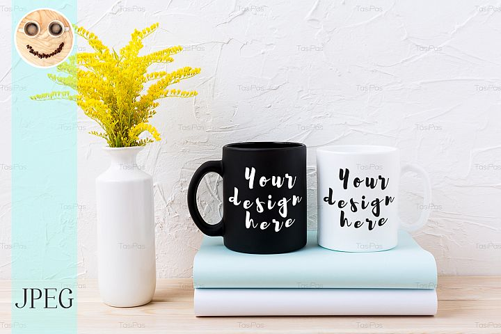 White and black mug mockup with ornamental yellow flowering
