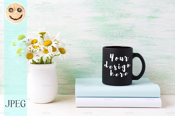 Black coffee mug mockup with white field chamomile bouquet