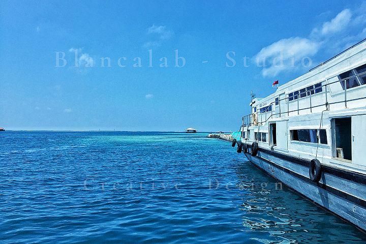 Ferry in Blue Ocean