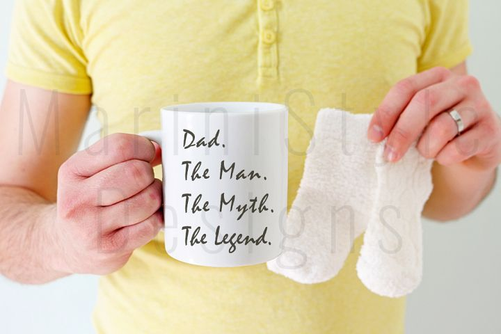 Mug mockup, best dad, man holding mug & baby socks, 389