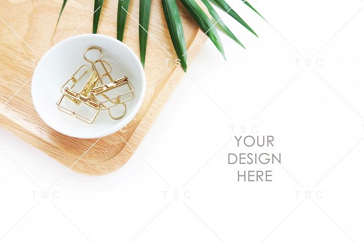 Paper Clips, Wooden Tray and Palm Leaf Stock Photo