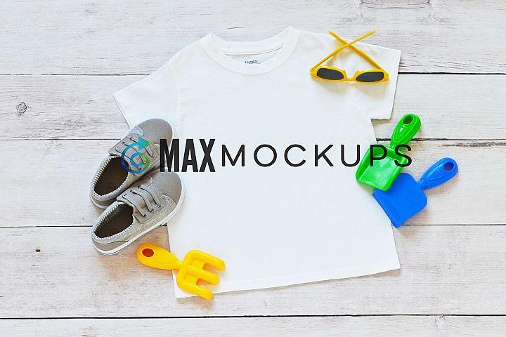 Kids t-shirt mockup, summer sun flatlay, styled photography