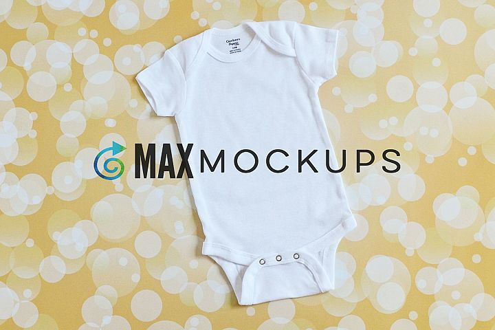 White baby bodysuit mockup, flatlay, with gold backdrop