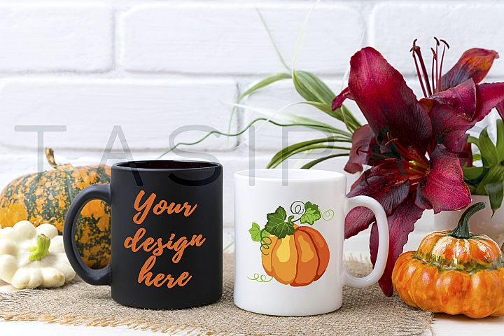 White and black mug mockup with pumpkin and red lily.