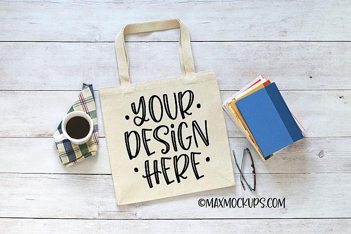 Canvas tote bag mockup, books and coffee theme