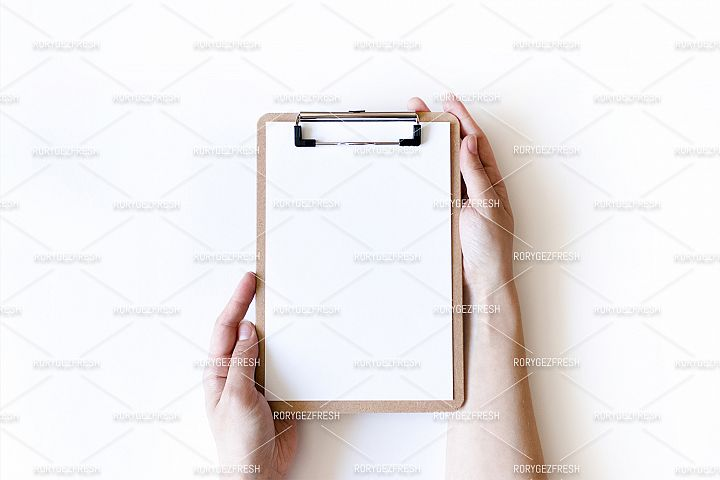 Girl hands hold a clip board on a white background