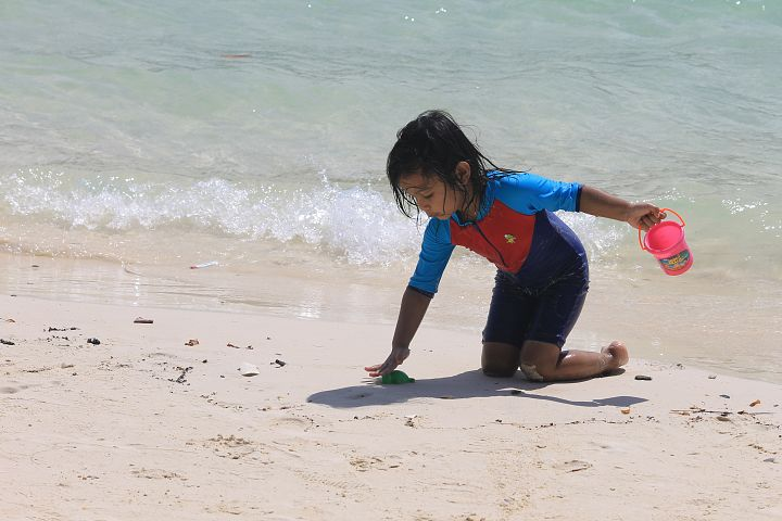 Baby Playing in Beach