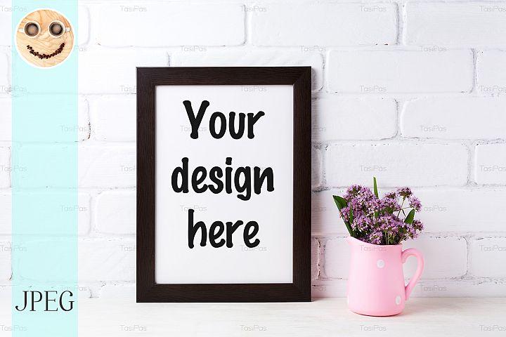 Black brown frame mockup with purple flowers in polka