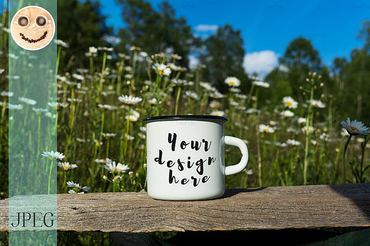 White campfire enamel mug mockup with daisy field