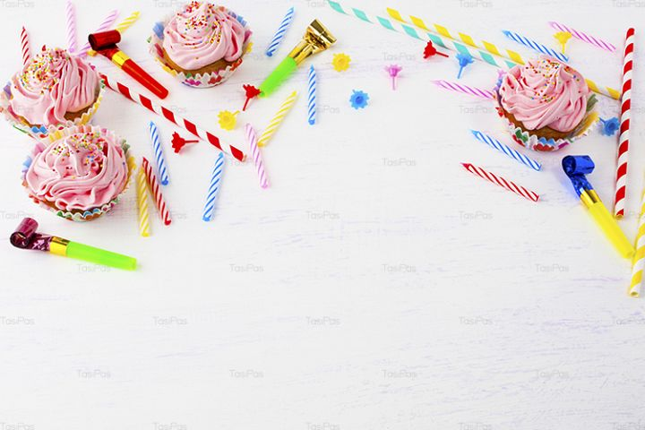 Birthday background with pink cupcakes and candles