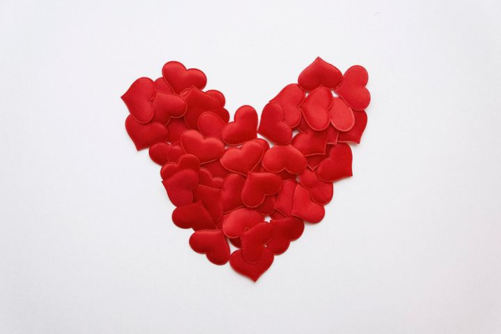 White background with small red hearts