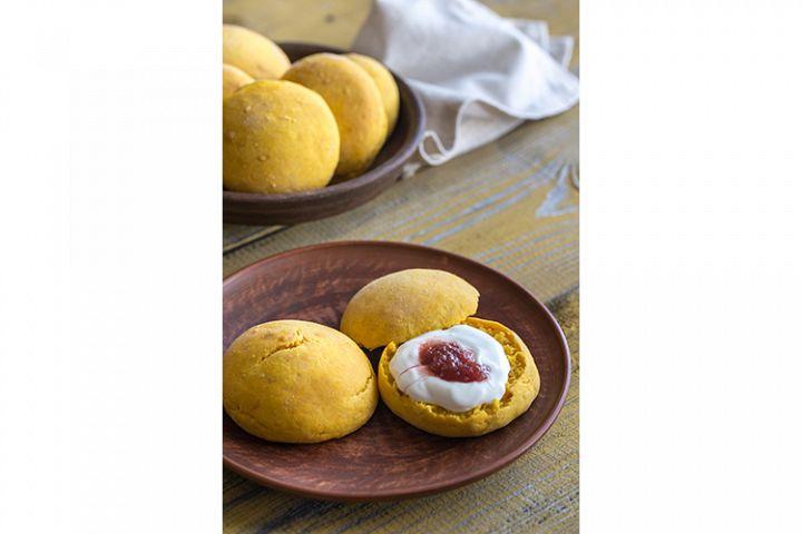 Pumpkin scones with cream and fruit jam