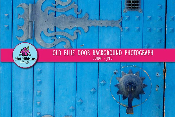 Ornate Old Weathered Blue Door with Wrought Iron Decorations