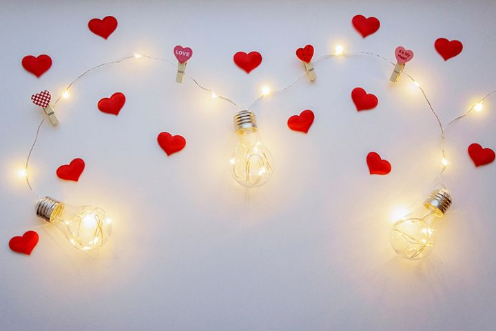 White background with lamps and small red hearts