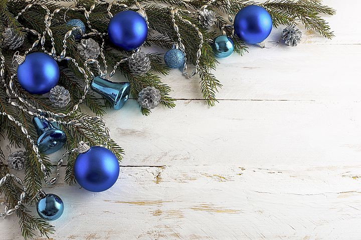 Christmas background with silver pinecone and blue ornaments