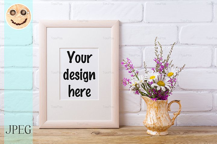 Wooden frame mockup with chamomile and purple flowers in gol